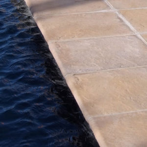 C.E.L. Paving Products Earth Slabs in Slate finish as a patio and pool surround
