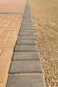 Grey Bonds with Earth Bonds and Exposed Aggregate Driveway Pavers