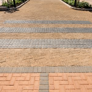 C.E.L. Paving Products commercial application of Coarse Exposed Aggregate pavers, Double cobbles, and bond pavers