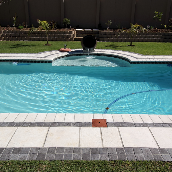 C.E.L. Paving Products residential application of Surefoot coping in pool surround, cobbles and slate slabs
